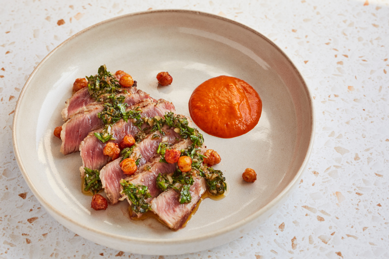 Iberico pork presa with chimichurri and red pepper purée