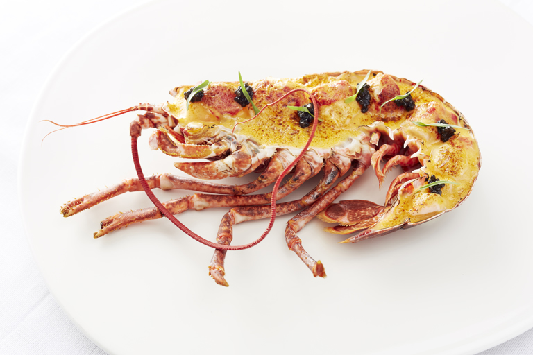 Lobster and caviar gratin served in the shell
