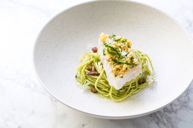 Cornish cod loin with spaghetti, wild garlic pesto, crispy pancetta, panna grata