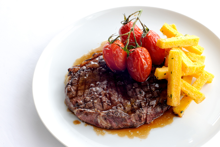 Rib-eye of beef with polenta chips