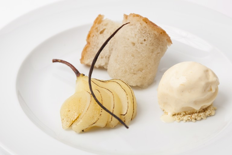 Rum baba with spiced, poached pears and ginger ice cream