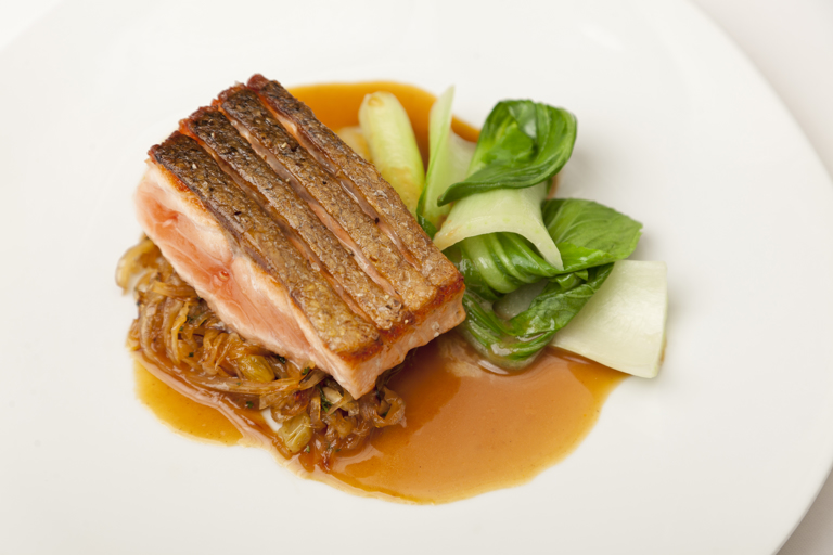 Crispy Alaska salmon with sweet and sour cabbage and spicy sauce