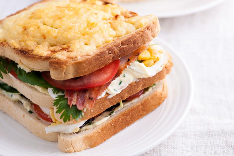 Bacon, egg, tomato and cheddar-garlic mayo club sandwich