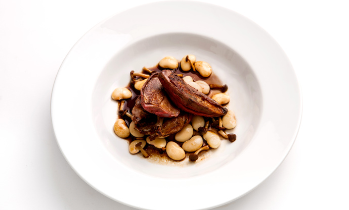 Roast pigeon with braised butter beans