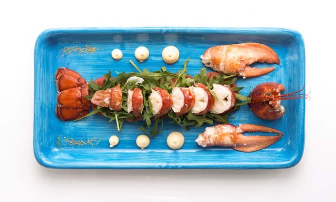 \capri lobster with tomatoes, rocket salad and marinated spring onion