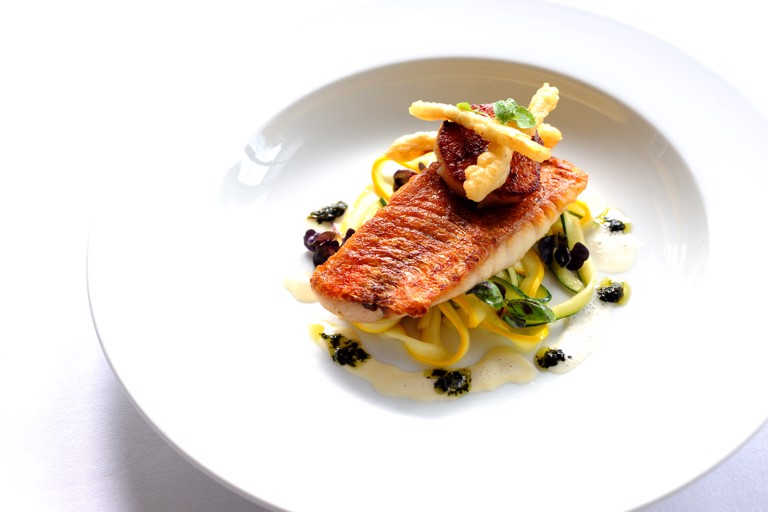 Pan-fried red mullet on courgette tagliatelle with scallops and purple basil pesto