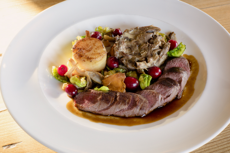 Fillet and flaked leg of hare with cranberries and sprout leaves