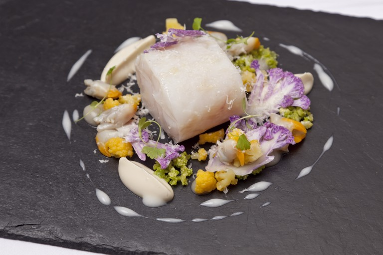 Confit pollock with cauliflower, cockles and Parmesan
