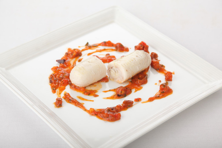 Skate with chorizo, olive and onion sauce