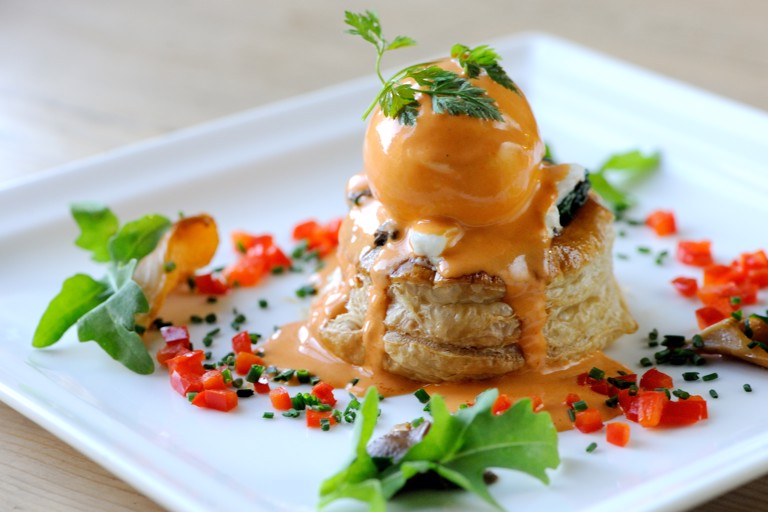 Wild mushroom, spinach and goat's cheese vol-au-vents with poached duck egg and pimento cream