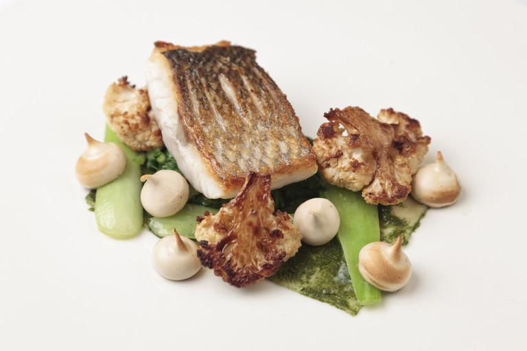 Sea bass with soy sauce meringue, pak choi and cauliflower
