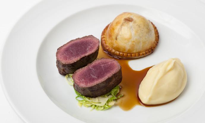 Roast loin of venison, wild mushroom pie and parsnip purée