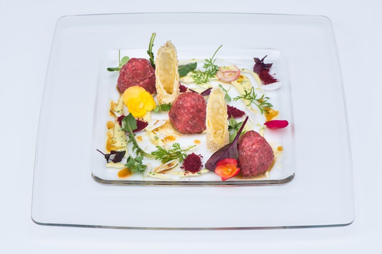 Beef tartare with sesame cannelloni and olive oil and chive sauce