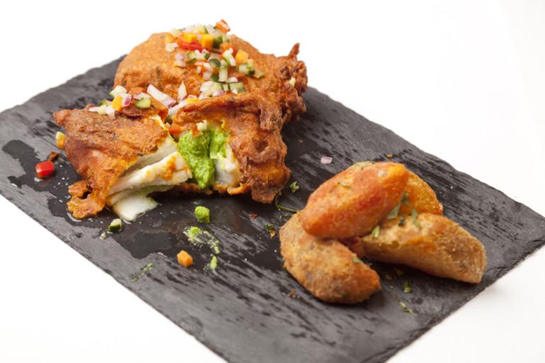 Amritsar-spiced Alaska halibut with mustard mushy peas, caper kachumber and tandoori potato wedges