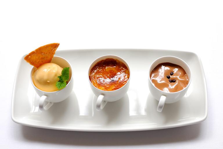 Tonka bean crème brûlée with apricot sorbet and chocolate emulsion