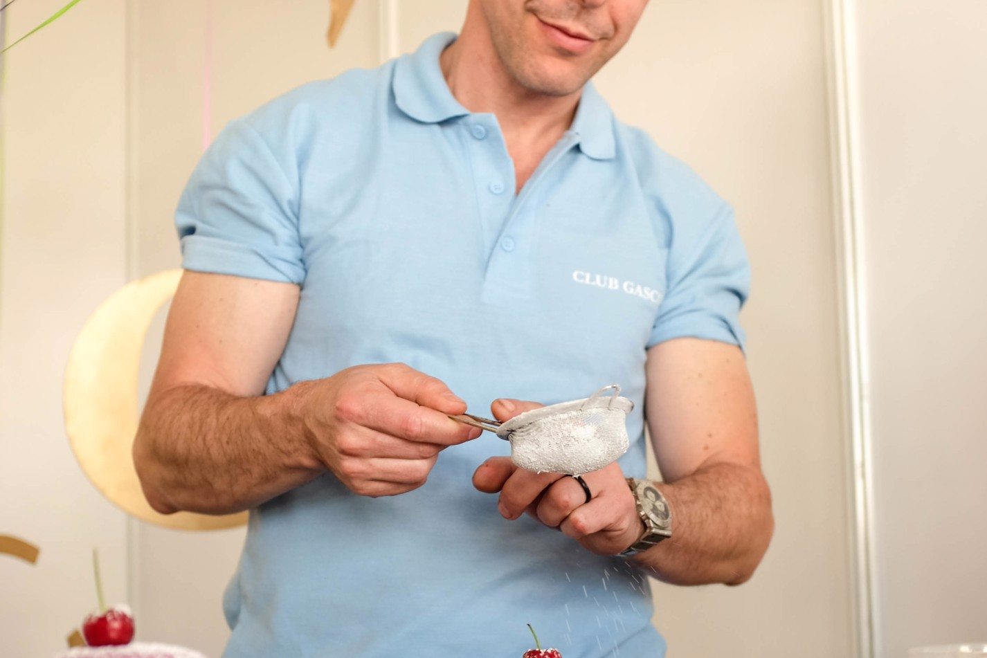 Pascal Aussignac puts the finishing touches to his macarons