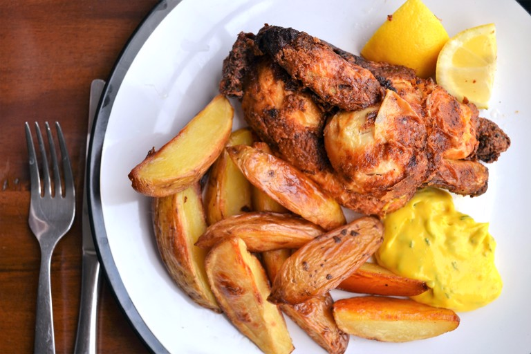 Deep-fried poussin with tarragon mayonnaise and potato wedges