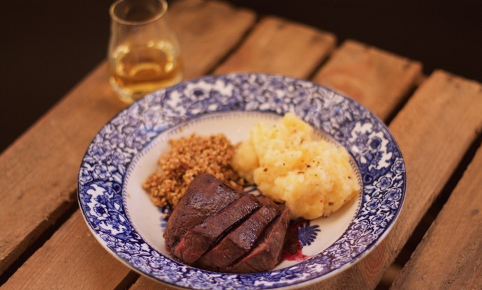 Pan-roasted loin of venison with redcurrant jelly
