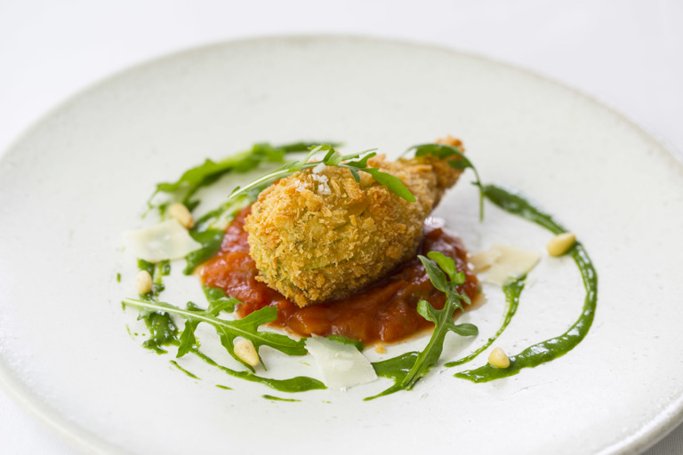 Crispy stuffed courgette flower with tomato fondue and basil sauce