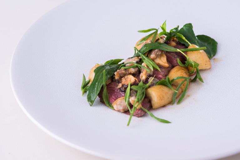 Hanger steak, clams, smoked garlic, sea vegetables
