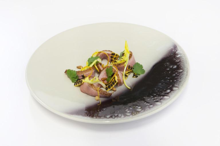 Salad of duck breast with orange, pine kernels and dandelion