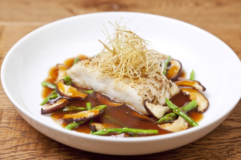 Spice-crusted Alaska black cod, onion sauce, shiitake and asparagus
