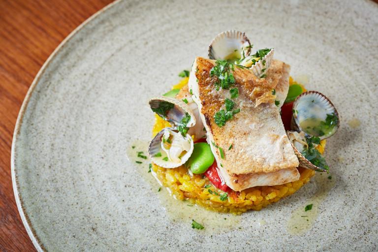 Gurnard with paella rice and clams