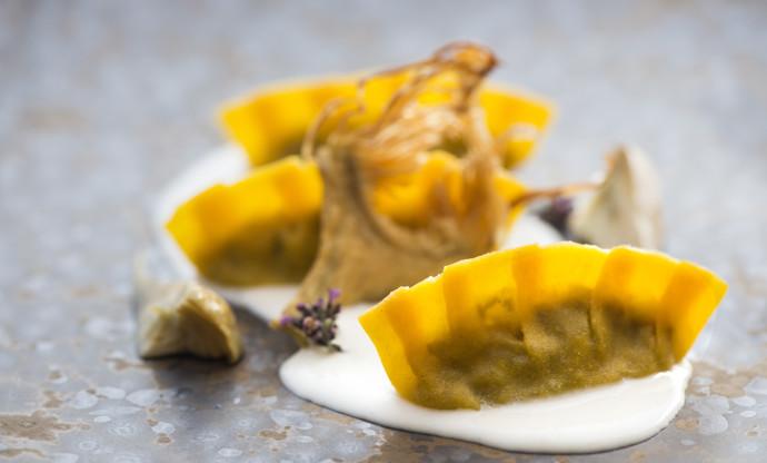 Crescent-shaped ravioli with artichokes, pecorino and thyme