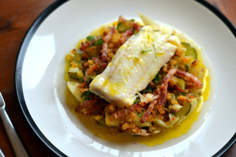 Braised fennel and cucumber with sourdough crumbs, smoked pancetta and baked cod loin