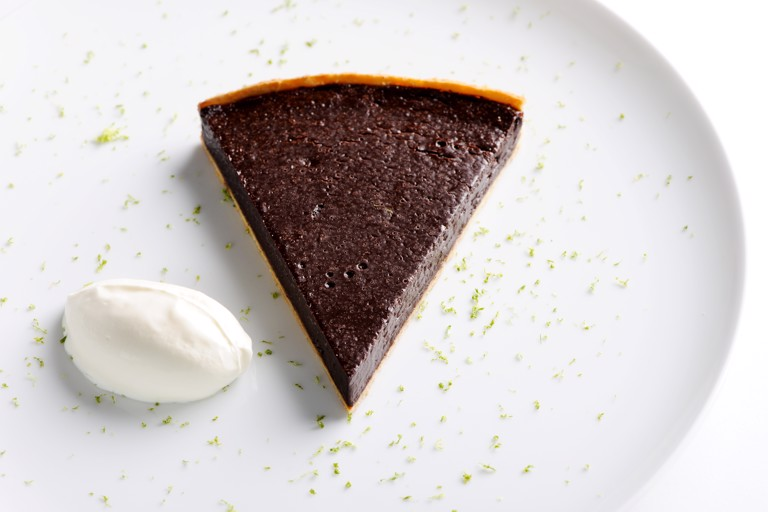 Chocolate and chilli tart with crème fraîche and lime