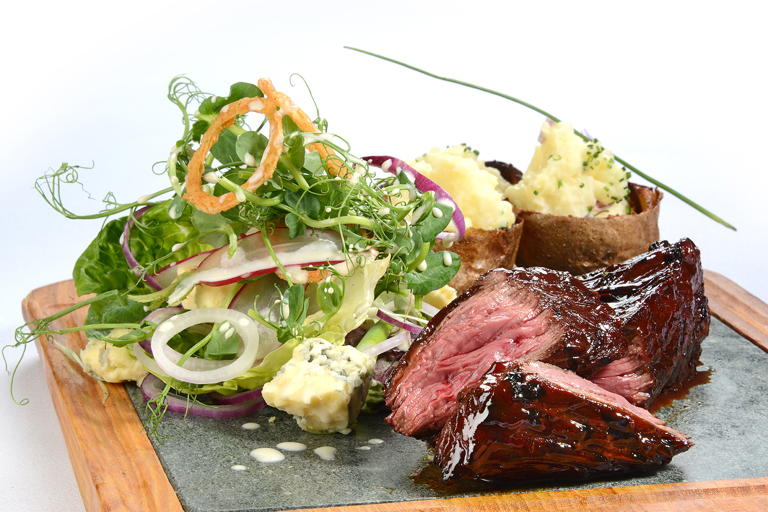 Organic chargrilled hanger steak, loaded potato skins, baby gem and blue cheese salad