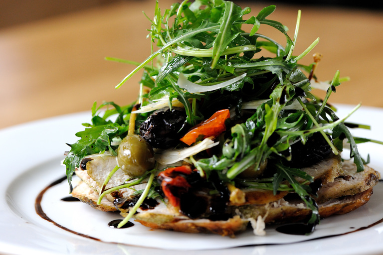 Chicken paillard with caper berries and roasted plum tomatoes