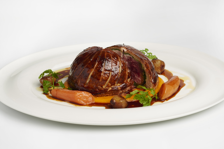 Pithivier of game, carrot purée and glazed onions