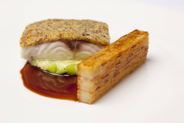 Sea bass with mustard crust and potato terrine