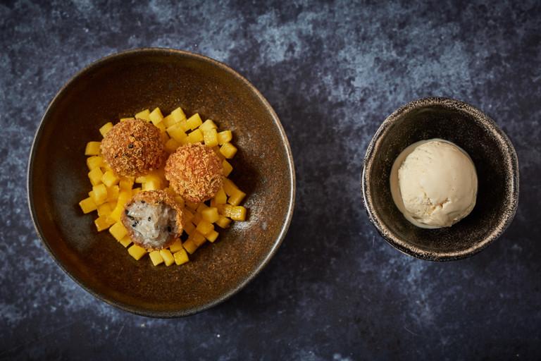Coconut rice pudding arancini with yoghurt sorbet and mango