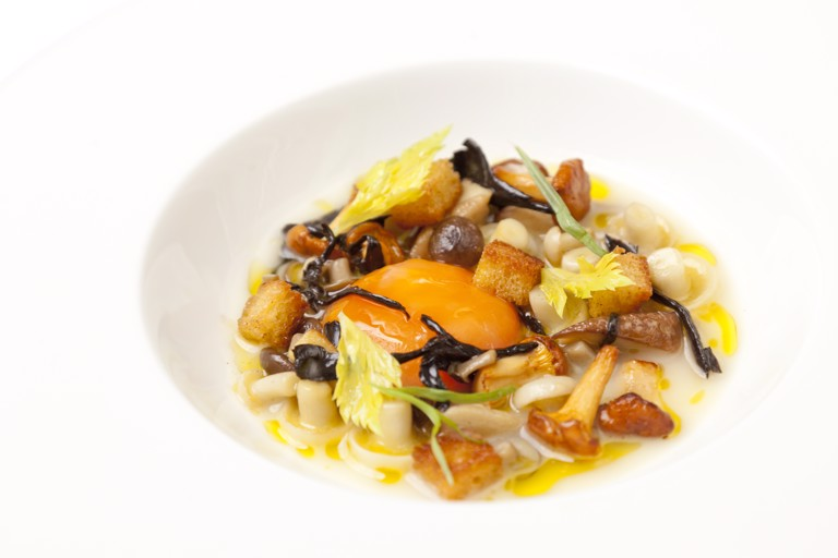 Chicken soup with glazed wild mushrooms and confit egg yolk