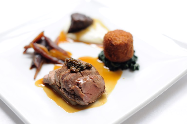 Pork cooked three ways with cauliflower purée, Swiss chard and Ravigôte sauce