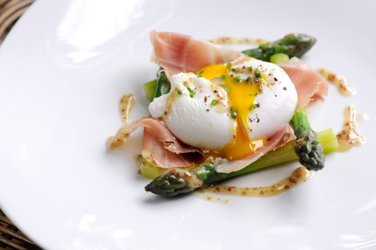 Poached duck egg with English asparagus, cured ham and grain mustard dressing