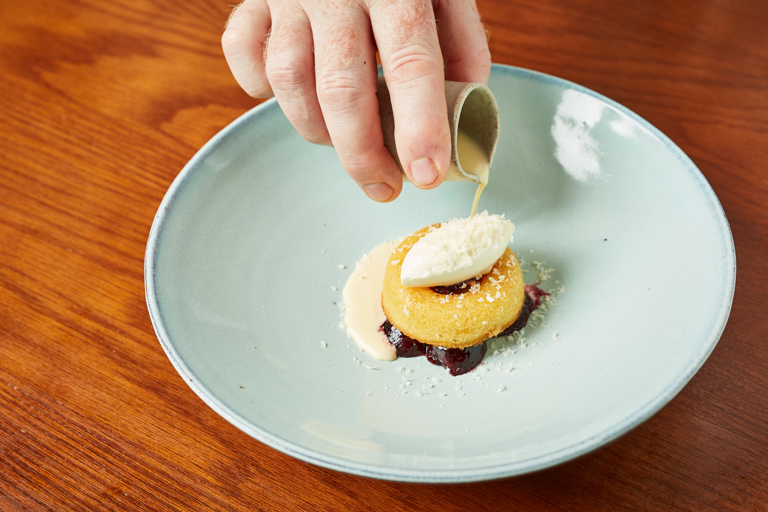 Poached cherries with frangipane, clotted cream ice cream and almond soup