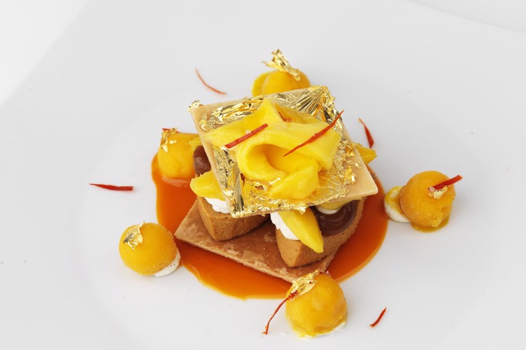 Caramel mille feuille, mango and gold leaf press and crystalised chilli
