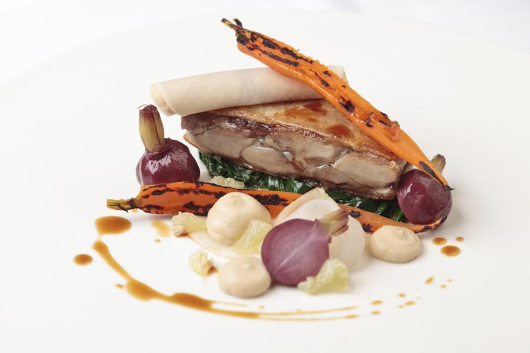 Steamed duck leg with glazed carrots, lemon and turnip