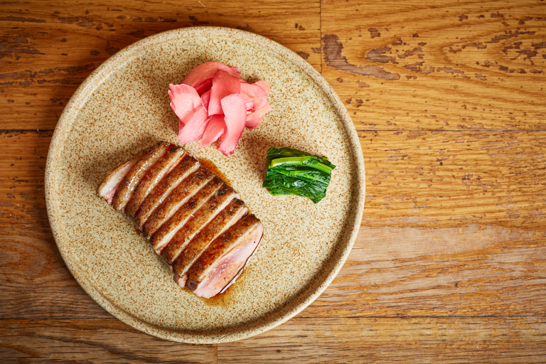 Grilled duck with burnt soy and rhubarb ginger pickle