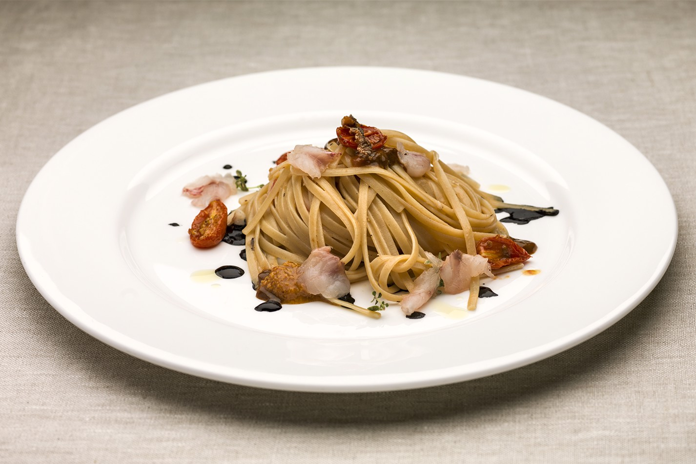 Luca Torricelli, Switzerland – Bavette with red mullet, sea urchins and squid ink