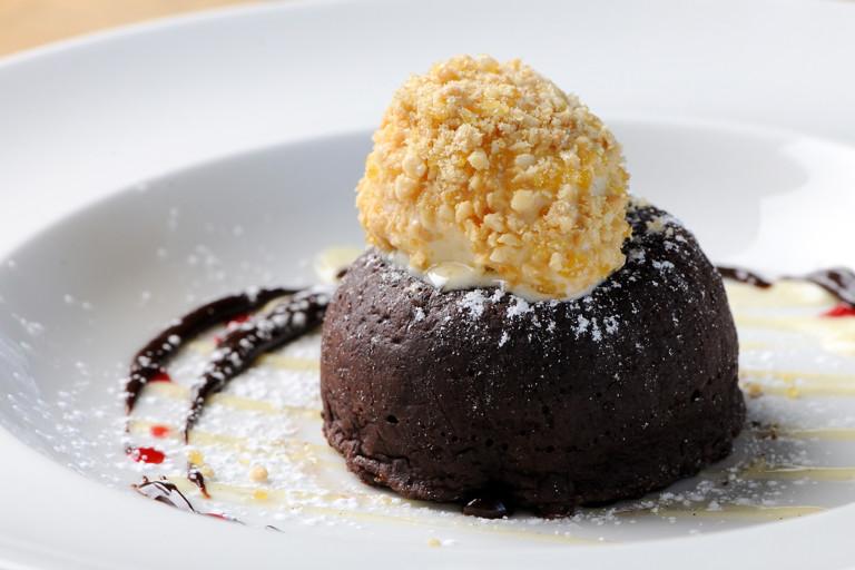 Chocolate fondant with peanut butter ice cream and dark chocolate sauce