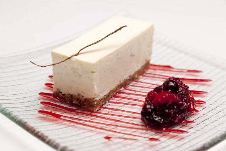 Vanilla cheesecake with red berry compote