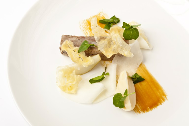 Pig's head terrine with parsnip toffee, pear, cumin and watercress