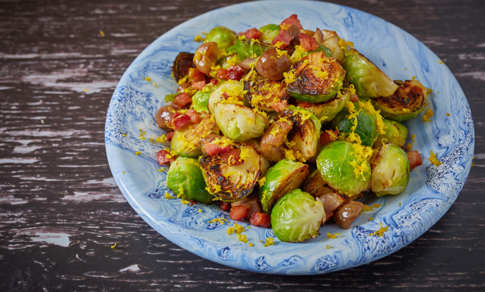 Charred sprouts with orange zest, chestnuts and pancetta