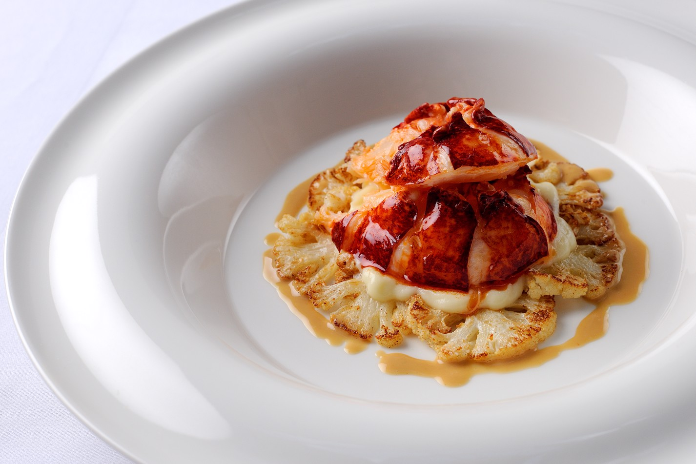 Poached lobster tail with cauliflower and butter sauce
