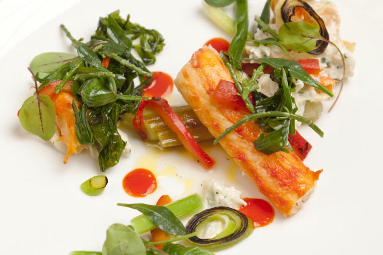 Alaska king crab, leeks, red pepper and cardamom dressing and sea vegetable salad