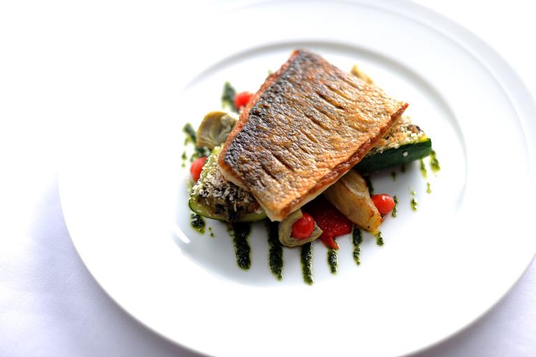 Griddled South Coast sea bass with provençal vegetables and basil oil
